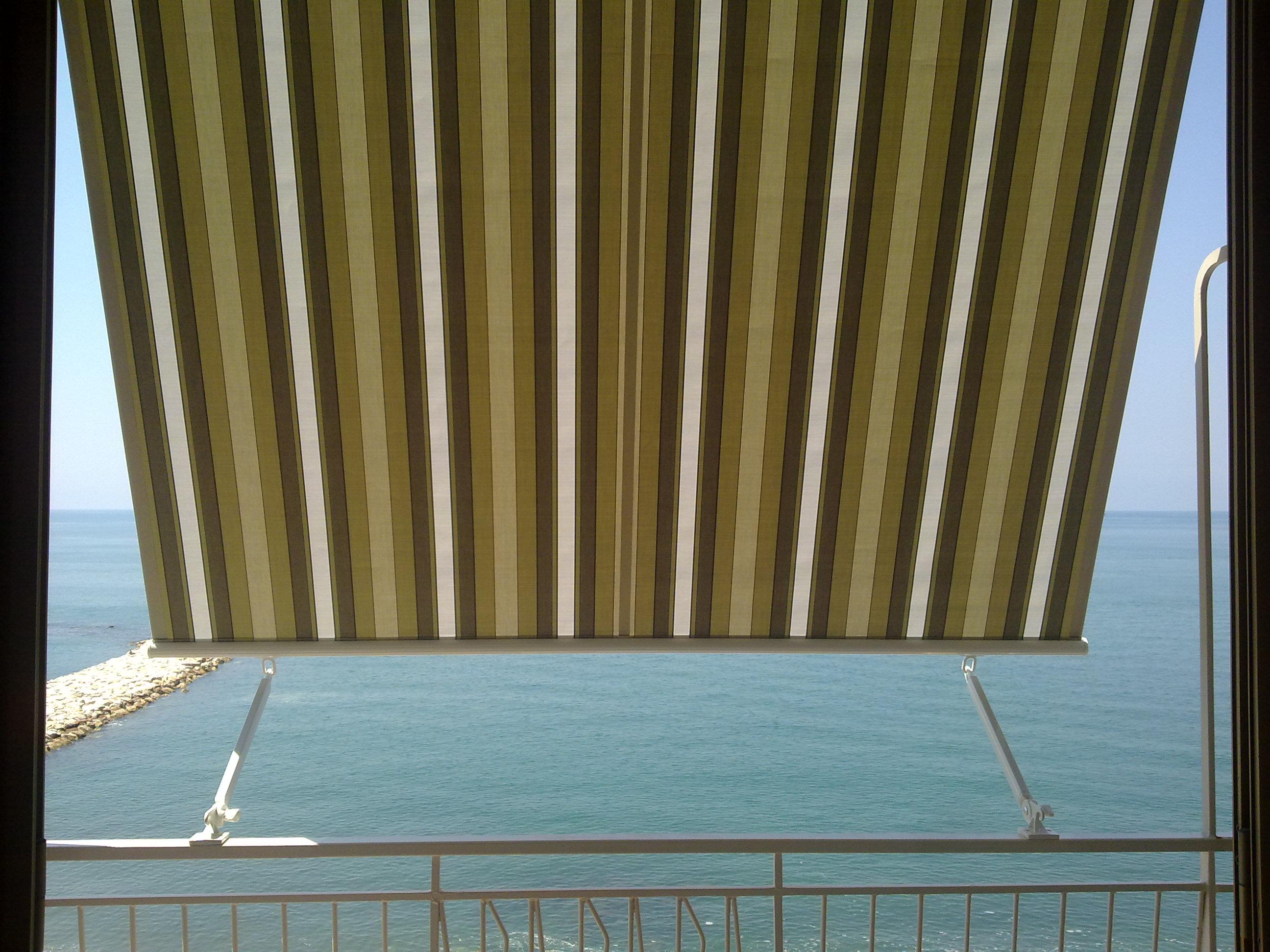 tenda da sole mod. a caduta • arredo tendaggi